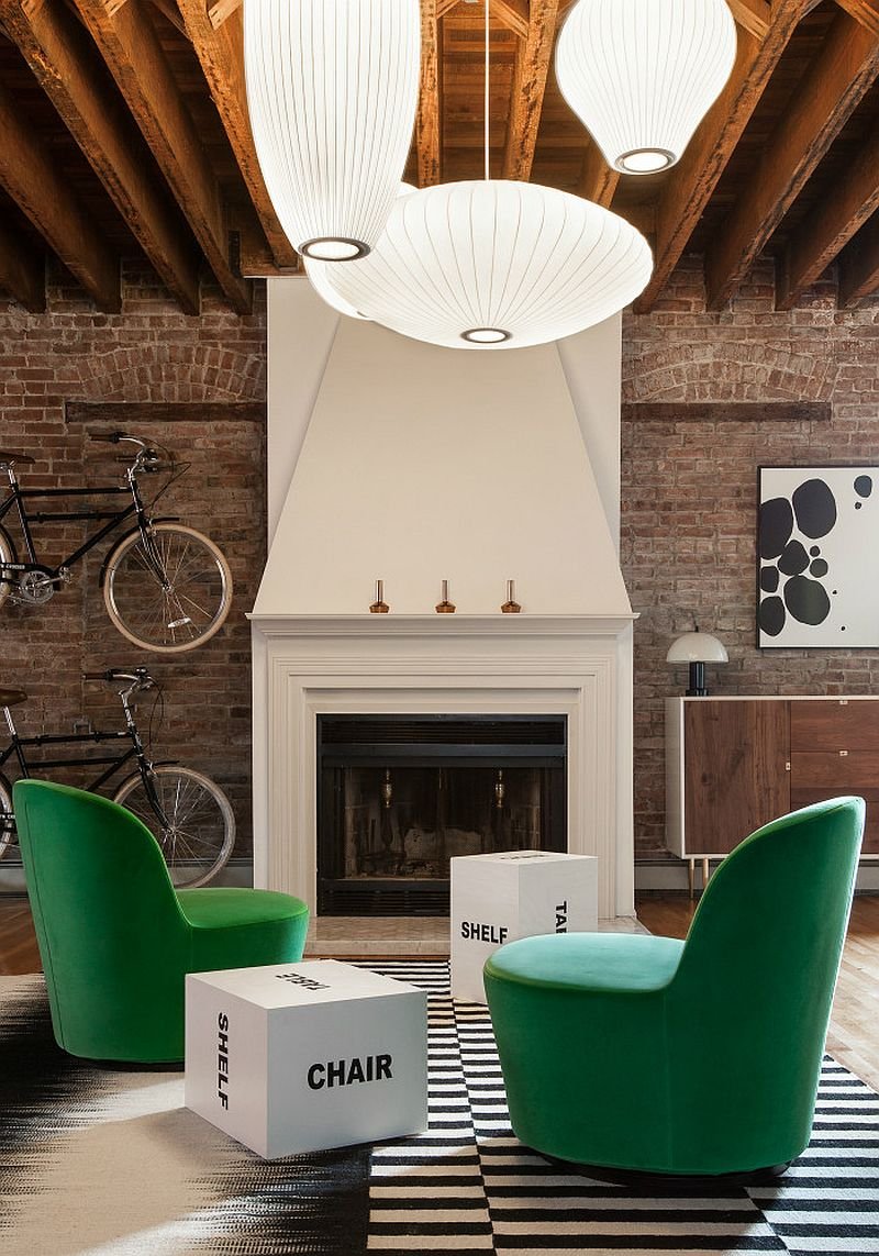 Black and white rug and green velevt armchairs from IKEA in the living room Urban Industrial: Loft Apartment in Jersey City Turns to Vivacious Color