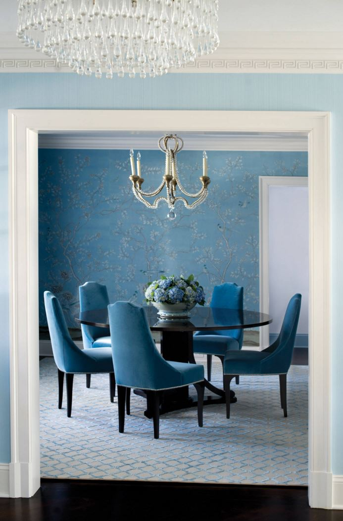 Blue walls lead to a blue dining room