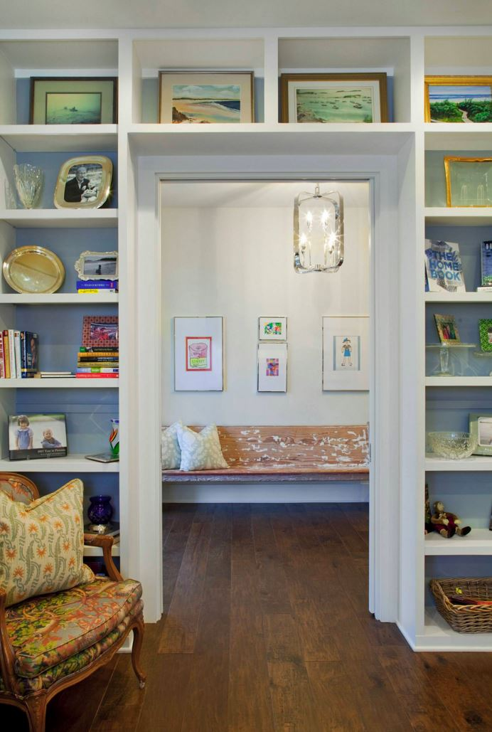 Bookshelf-lined room with a gallery wall view