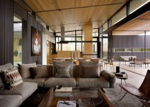 Breezy living room of Courtyard Residence with industrial style