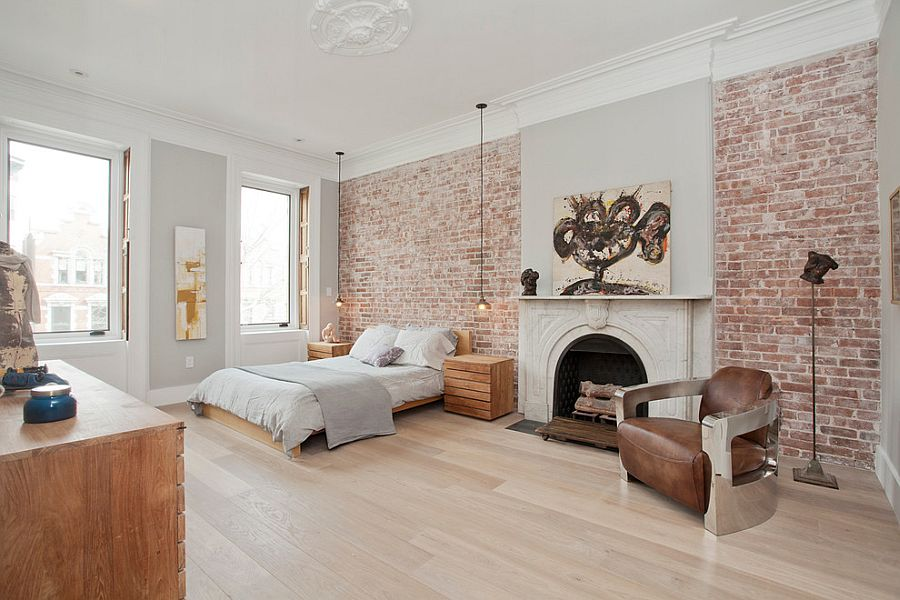 Brick walls add textural charm to the Scandinavian bedroom [Design: Jensen C. Vasil Architect]