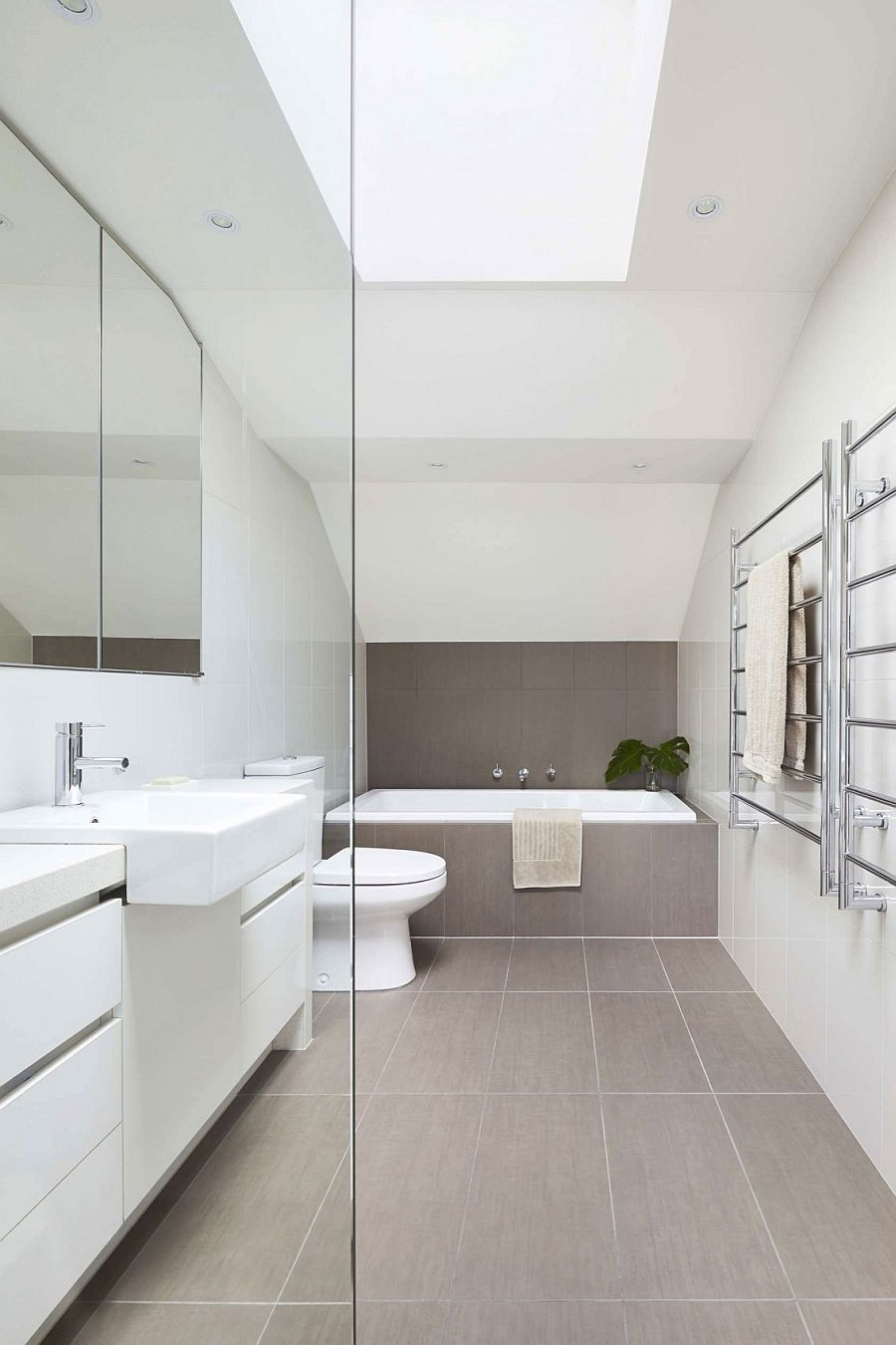 Bright and breezy contemporary bathroom with skylight