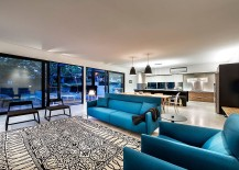 Bright blue sofas add color to the living area