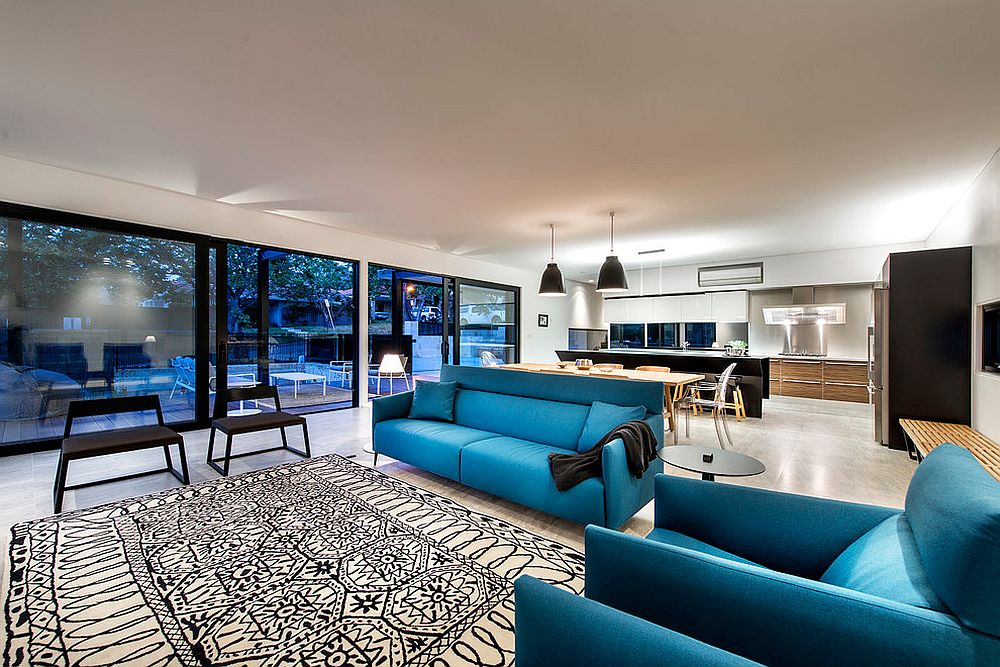Bright blue sofas add color to the living area [Design: Mata Design Studio]