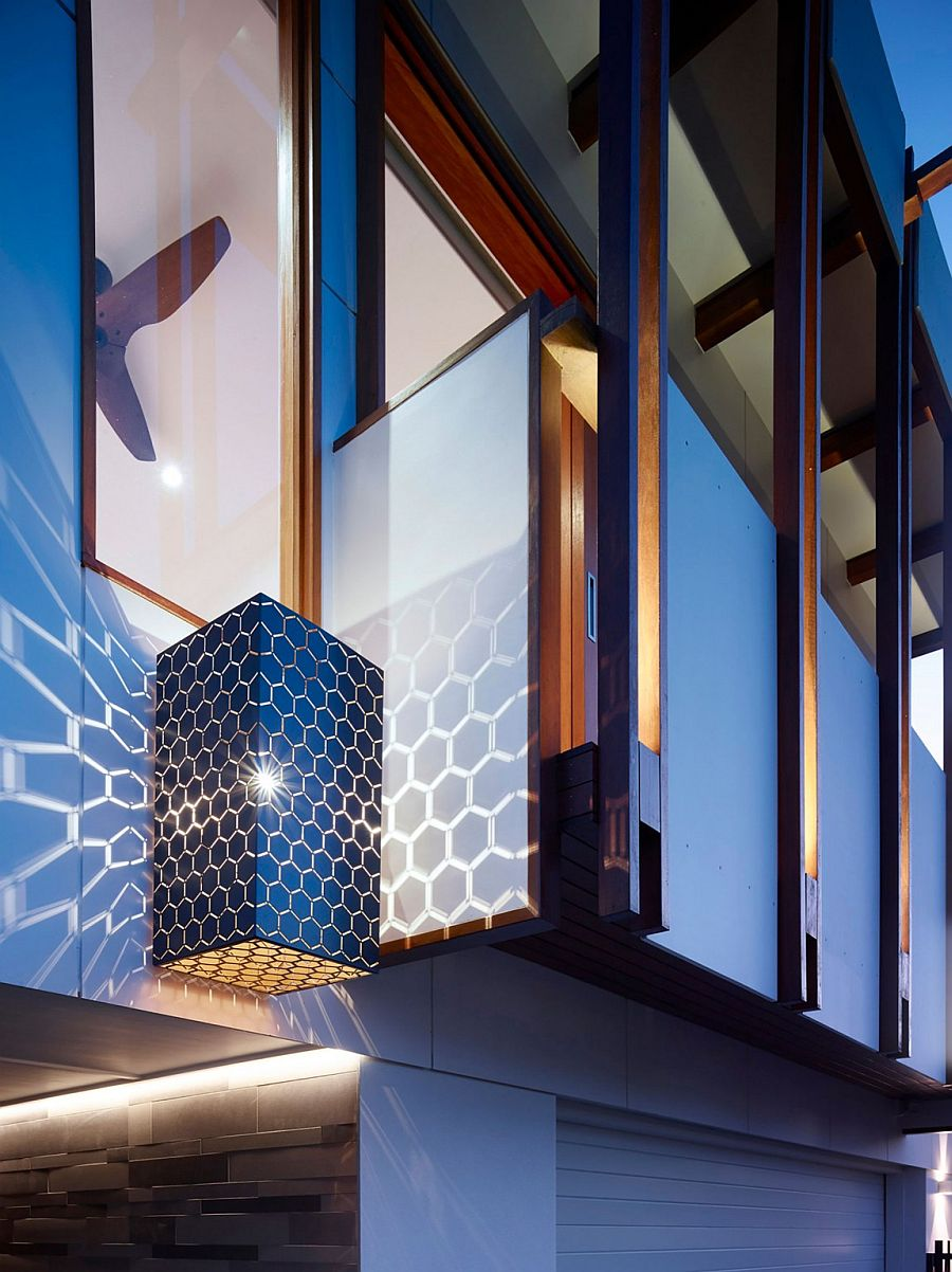 Brilliant lighting fixture adds hexagonal pattern to the walls around it!