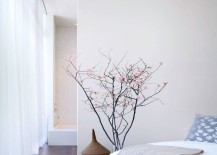 Cherry blossom branches in a modern bedroom