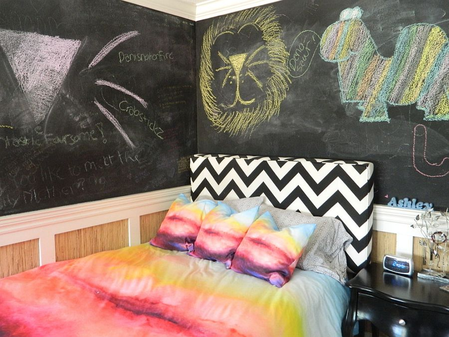 Chevron striped headboard holds its own in the eclectic bedroom with chalkboard walls [Design: Susan Thiel Design]