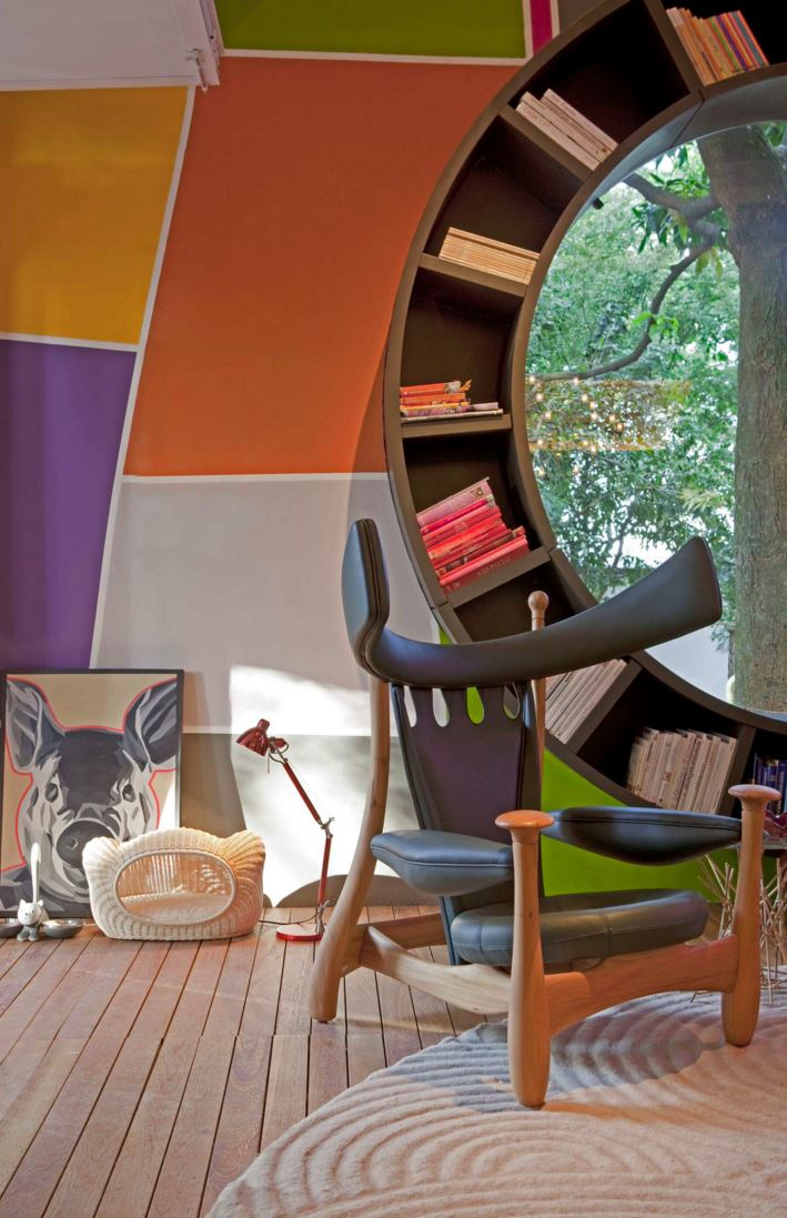 Circular bookshelf with color-coded stacks