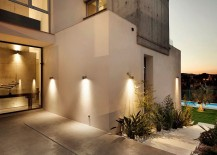 Clever lighting accentuates the garden features and illuminates the walkway