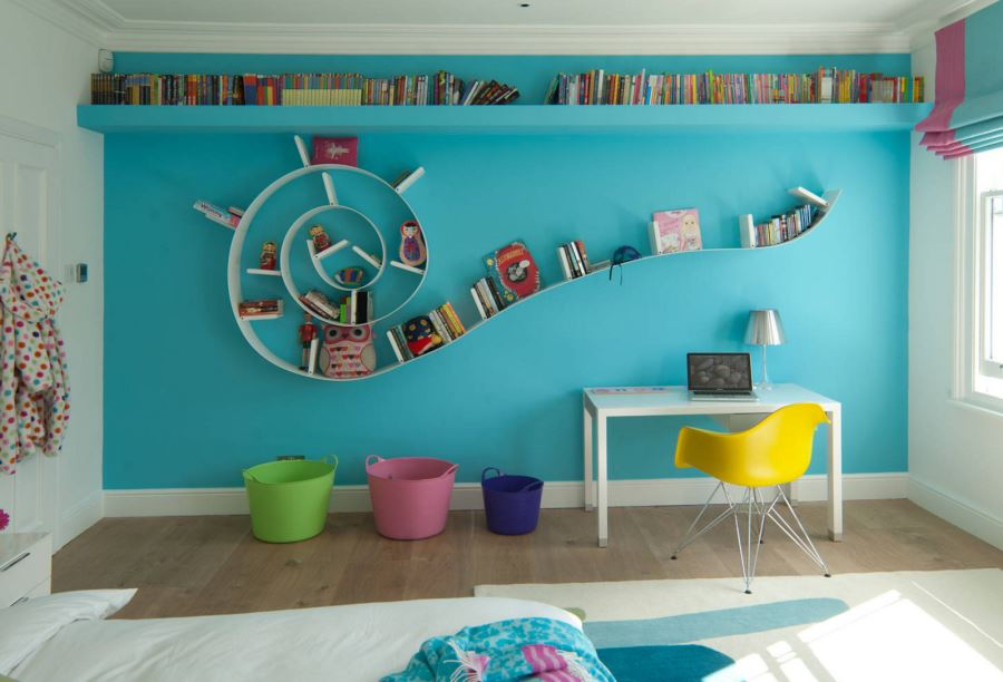 Colorful kids' room with a spiral bookshelf