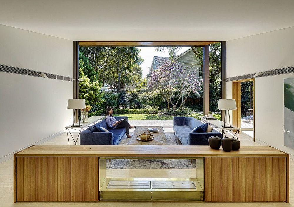 Colors of the garden enrich the spacious, contemporary living area