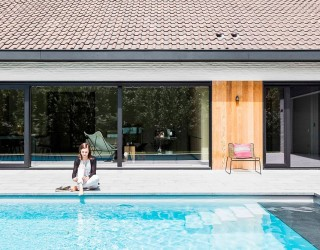 Refined Relaxation: 70's Belgian Bungalow Altered into a Minimal Modern Home