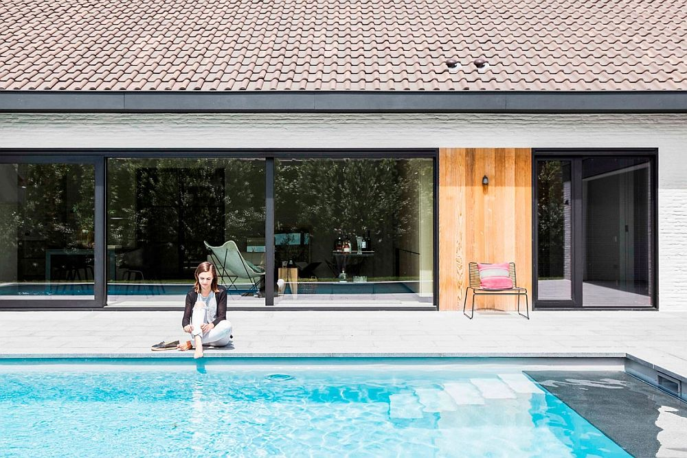Contemporary Belgium home with a relaxing pool area and backyard Refined Relaxation: 70's Belgian Bungalow Altered into a Minimal Modern Home