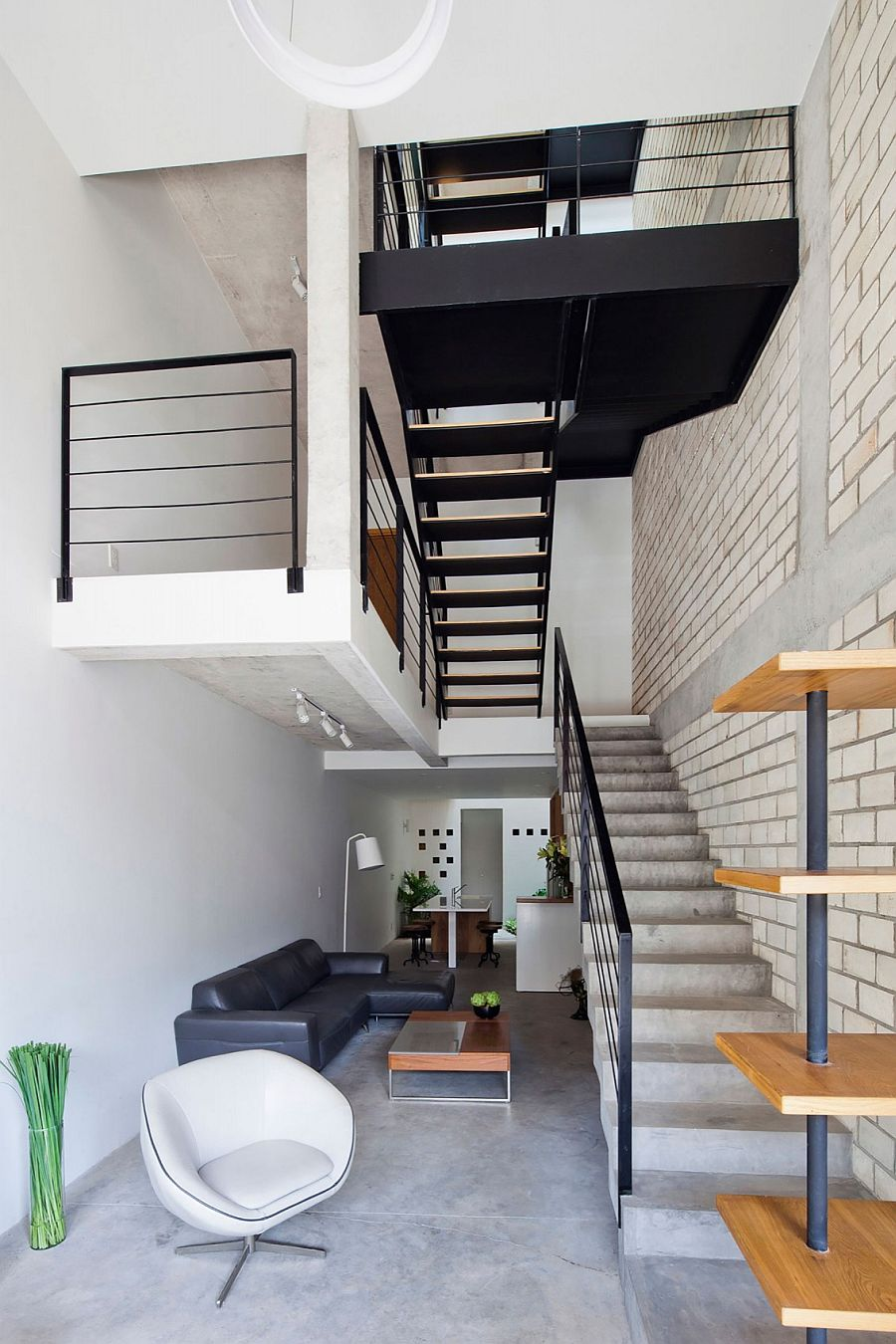 Contemporary and industrial styles come together at the 4-story Vietnam house