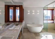 Contemporary bathroom with standalone bathtub in white
