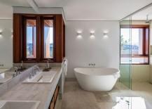 Contemporary-bathroom-with-standalone-bathtub-in-white-217x155