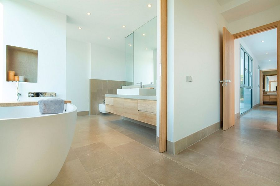 Contemporary bathroom with wooden vanity and minimal vibe