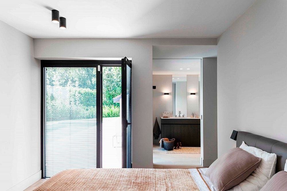 Contemporary bedroom with a view of the garden and the pool