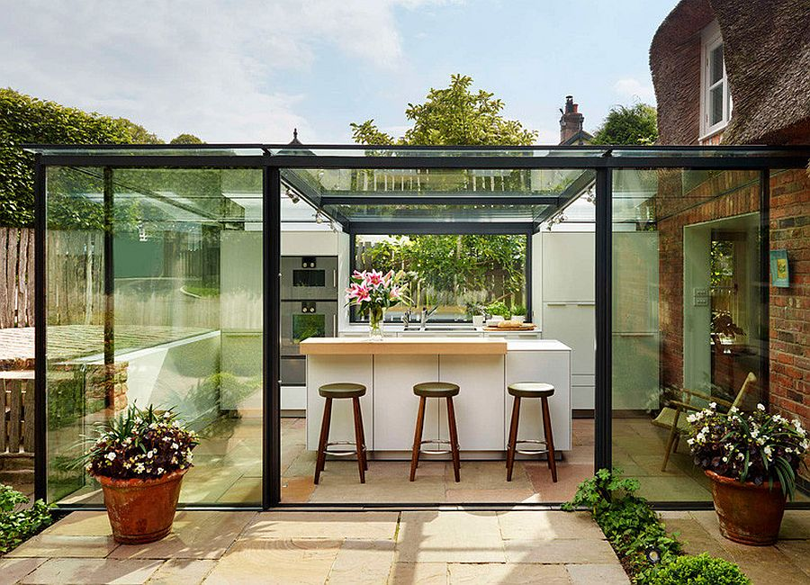 Contemporary glass kitchen extension for classic 18th century cottage in England
