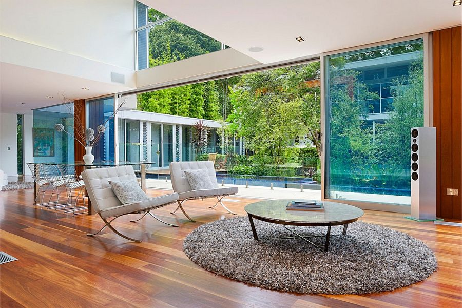 Contemporary interior with large glass wall and wooden flooring
