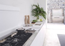 Contemporary kitchen in white with a sleek workstation