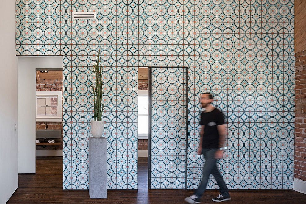 Contemporary renovation adds color and pattern to the brick-wallled interior