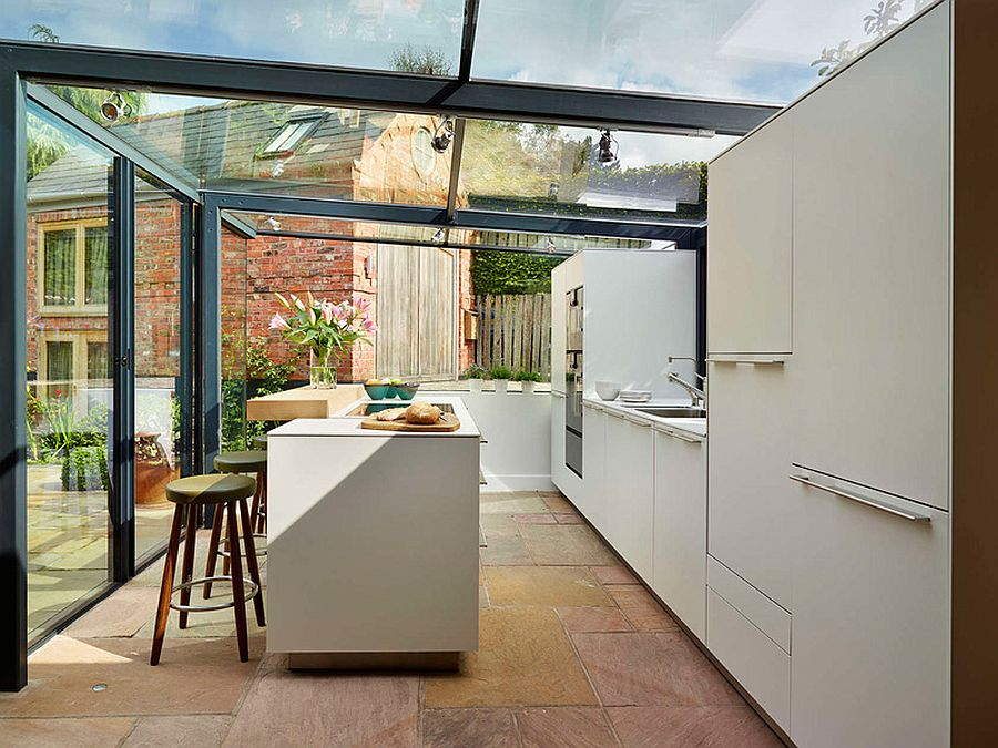 Cool Bulthaup kitchen encased in a glass box with steel frame and a stylish island