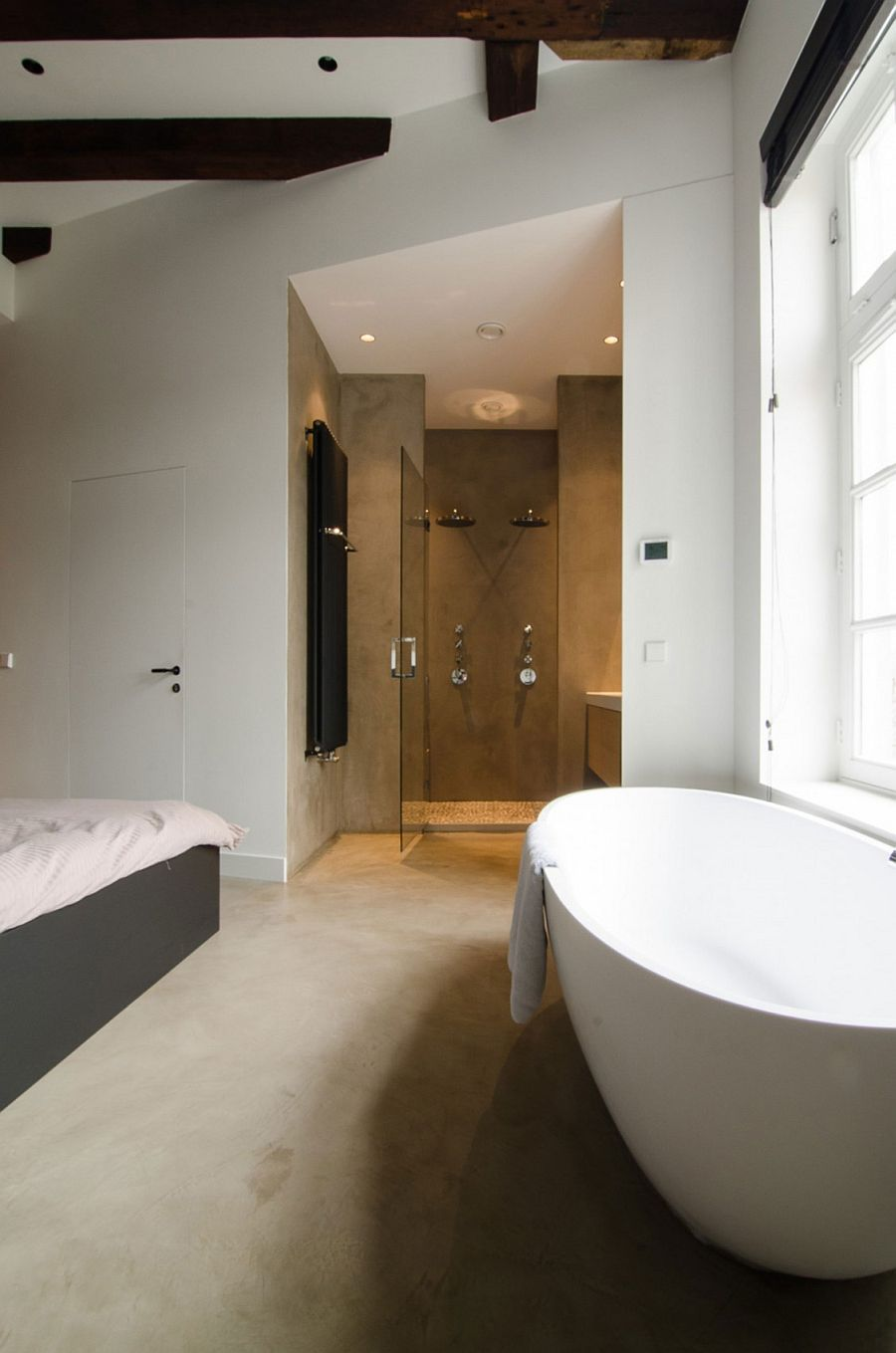 Corner shower area in the master bedroom with bathtub