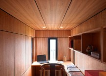 Cozy, small home office and study draped in wood