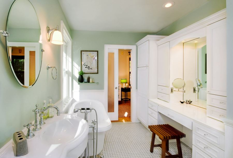 Crisp white bathroom with mint walls