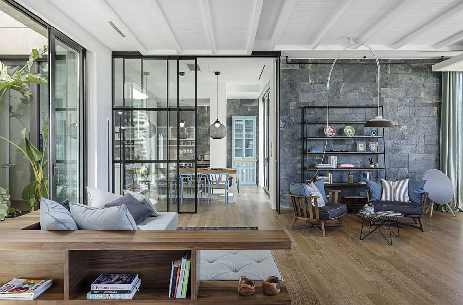 Custom couch and bookshelves add to the uniquness of the Y House in Turkey