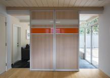 Custom-panels-hide-the-TV-in-the-family-room-217x155
