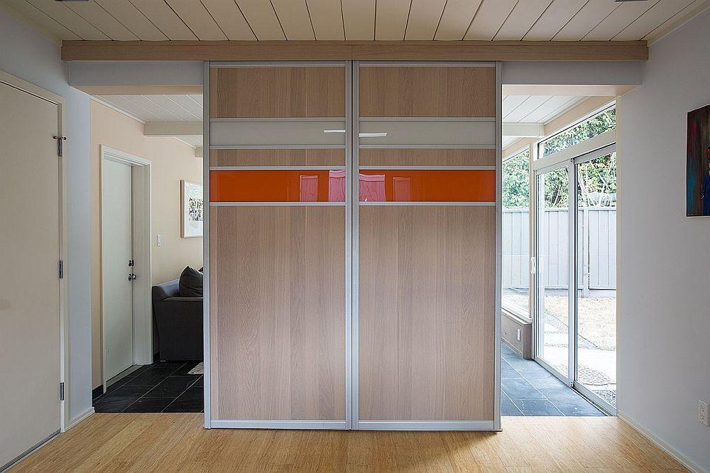 Custom panels hide the TV in the family room