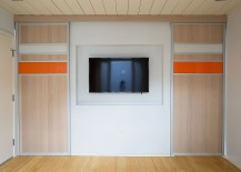 Custom-panels-separate-the-TV-room-from-the-sunroom-217x155