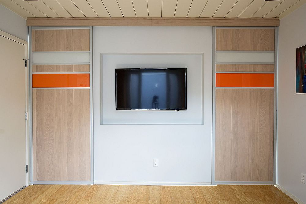 Custom panels separate the TV room from the sunroom