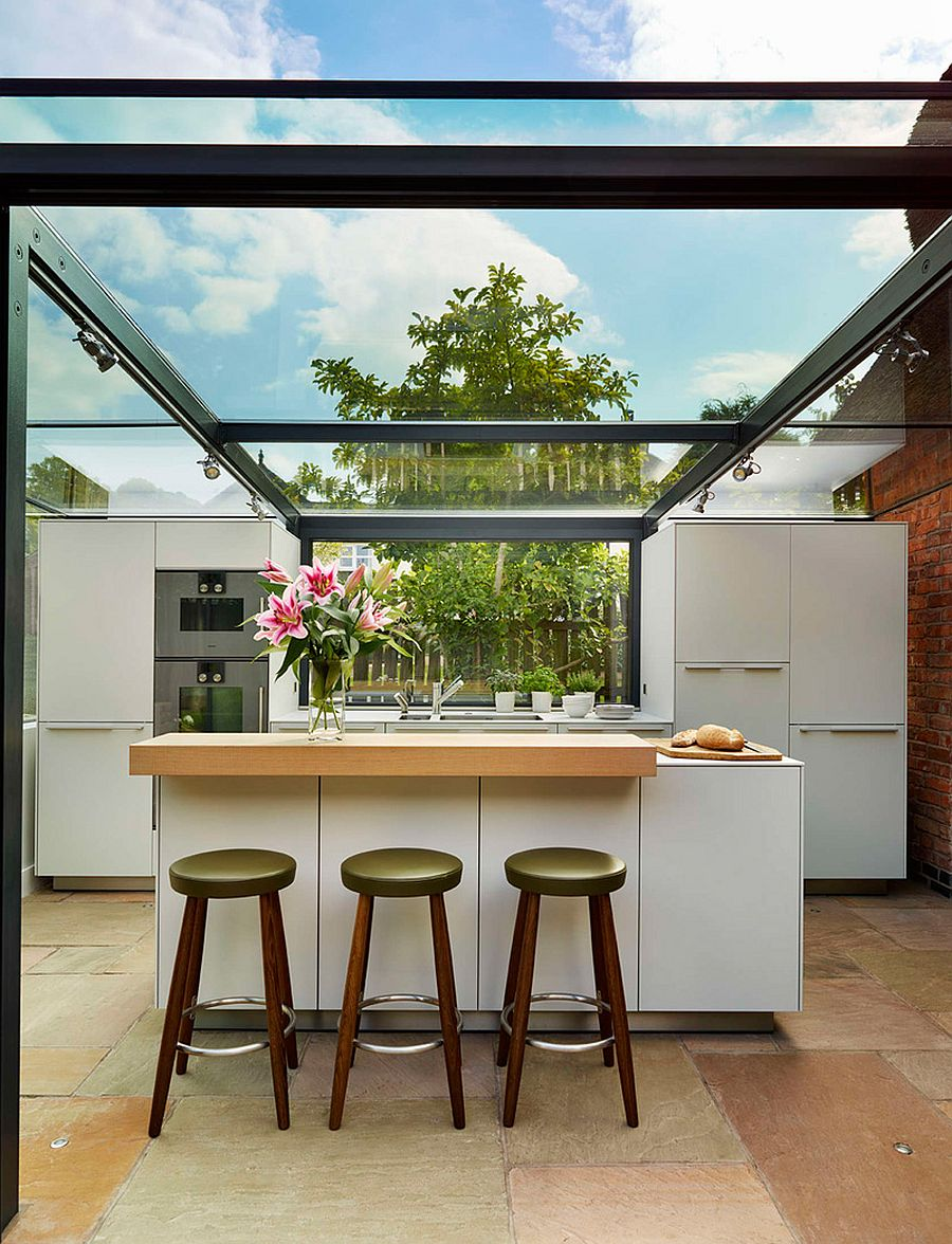 Dazzling contemporary kitchen extension for a 18th-century thatched cottage in England