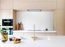 Design of the kitchen cabinets extend the living area visually
