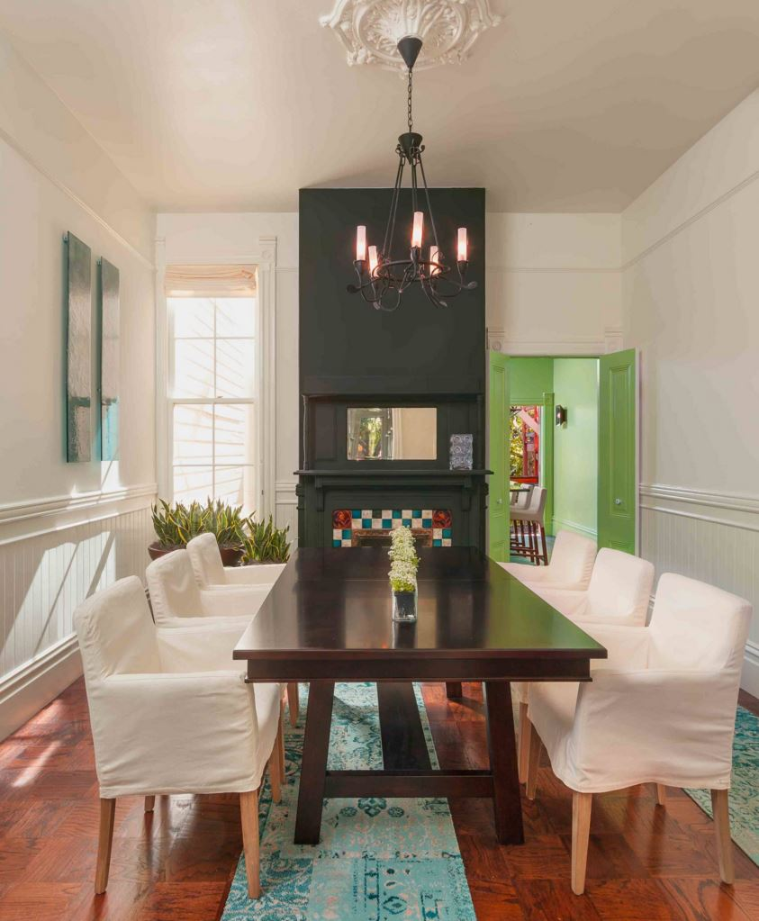 Dining room with a view to a green room