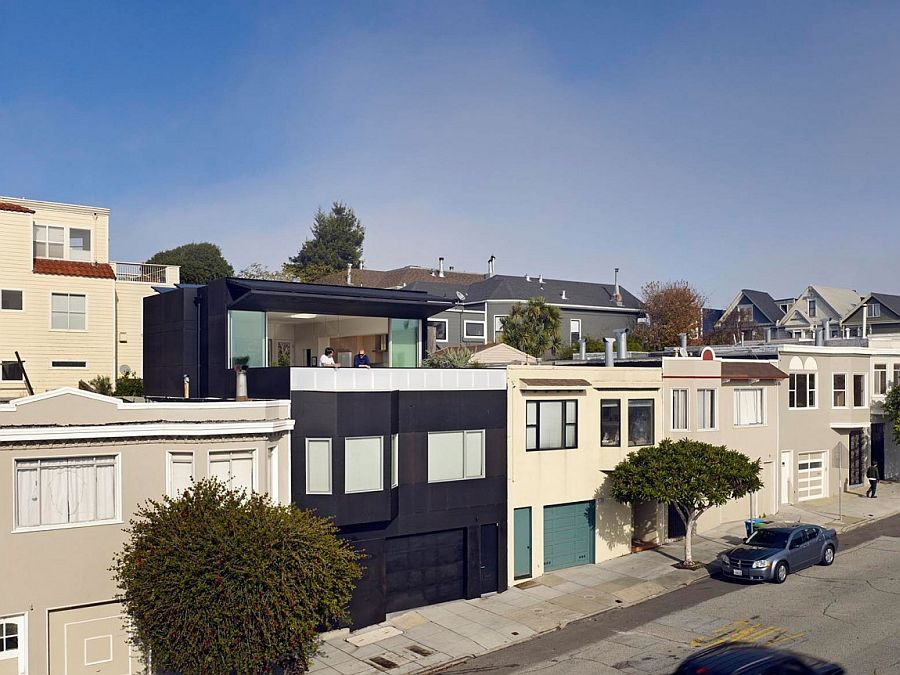 Distinctive and dark street facade of 20th St House in San Francisco