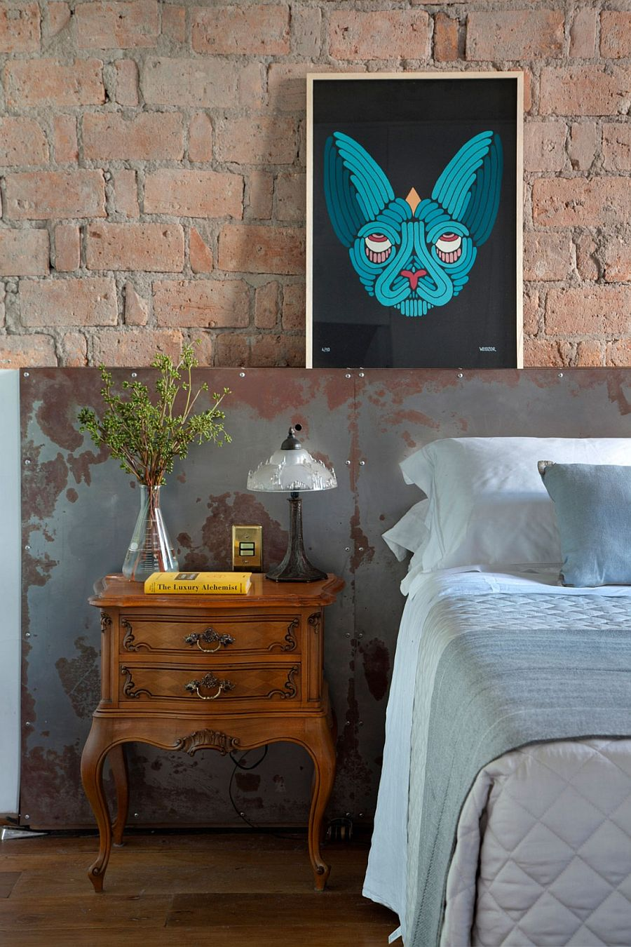Distressed finishes and antique decor make a splash in the modern industrial bedroom