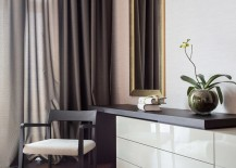 Elegant-bedroom-corner-with-draperies-and-an-orchid-217x155