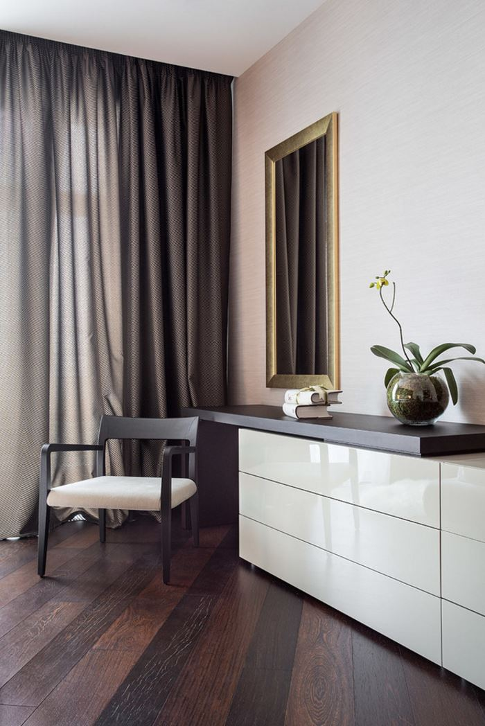 Elegant bedroom corner with draperies and an orchid