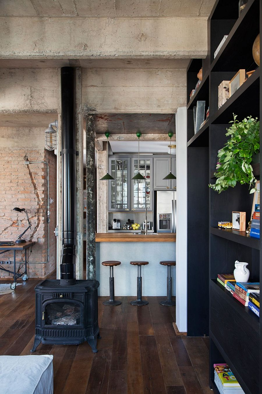 Exposed duct work, pipes and brick walls give the interior a distinct industrial appeal