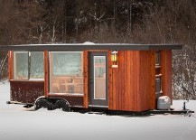 Exterior of gorgeous tiny home with cedar vertical siding and Cor-ten Steel panels