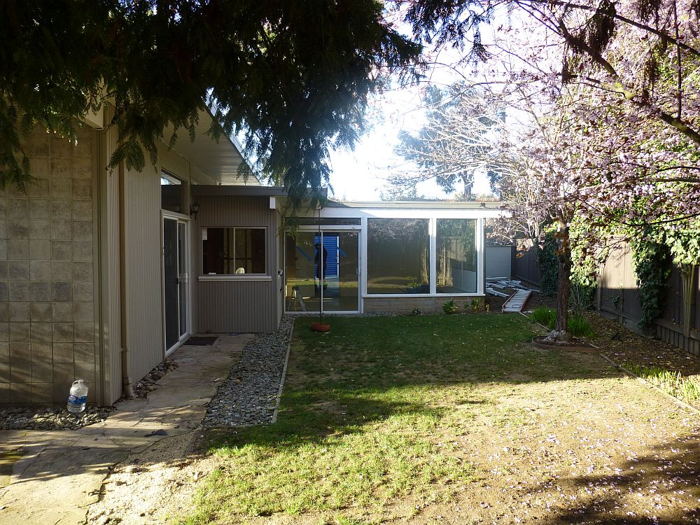 Exterior of the mid century home before the renovation