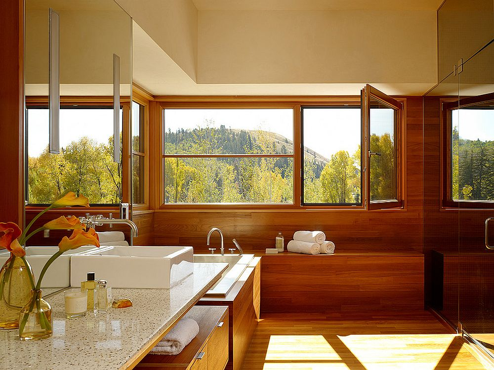 Fabulous wooden window seat adds to the opulence of the modern bathroom