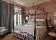 Farmhouse style bedroom with custom bed and striking wallpaper