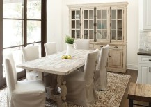 French country style dining room with a stylish hutch and dining table in wood