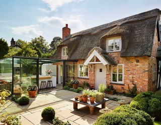 Dreamy 18th-Century English Cottage Acquires an Inspired Glass Box Kitchen