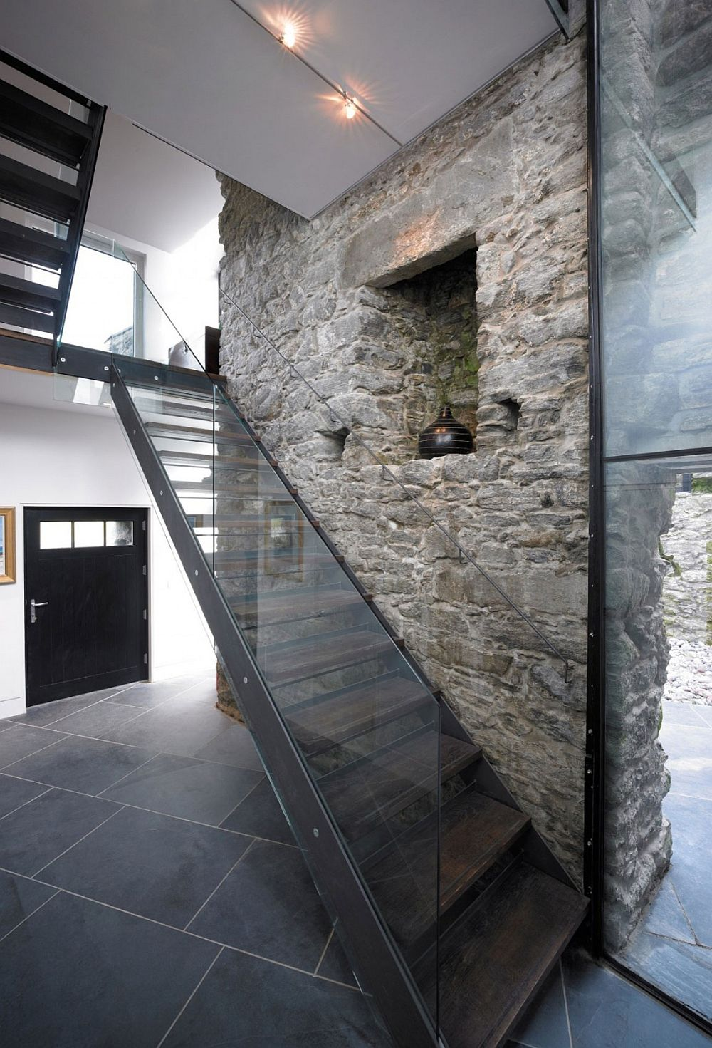 Glass, stone and steel come together inside the modern home